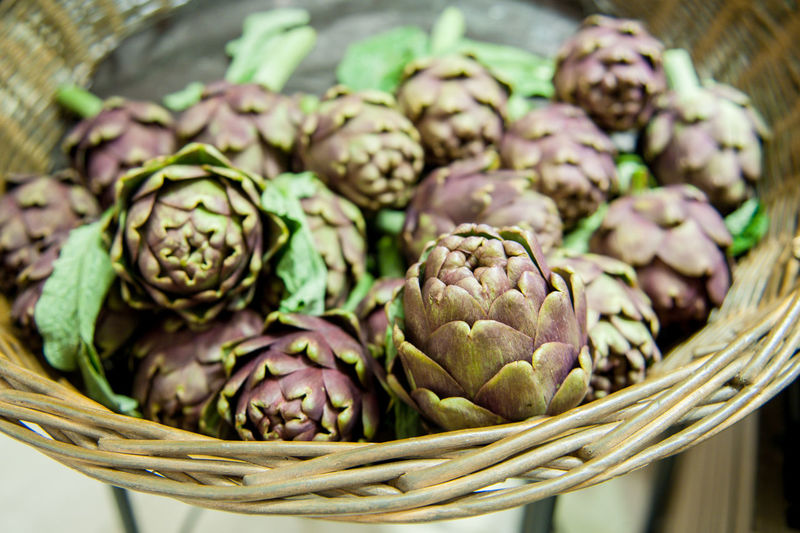 Aritchokes in market stall Artichoke Beauty In Nature Close-up Day Food Food And Drink Freshness Healthy Eating Large Group Of Objects Market Nature No People Outdoors Raw Shop Stall Vegetable