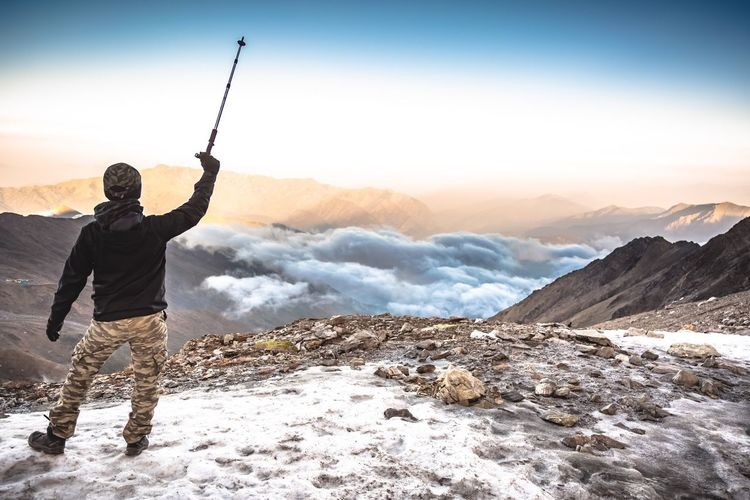 """Far Cry"" Roopkund Lake, Himalayas. The Great Outdoors - 2018 EyeEm Awards The Traveler - 2018 EyeEm Awards Mountain One Person Sky Beauty In Nature Leisure Activity Real People Lifestyles Scenics - Nature Nature Men Mountain Range Snow Environment Non-urban Scene Activity Winter Sunset Rear View Human Arm Outdoors"