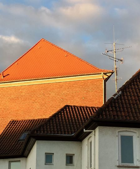 Built Structure Architecture House Building Exterior Roof Residential Structure Sky Residential Building Cloud Low Angle View High Section Chimney Cloud - Sky Orange Orange Color Day Brown Tiled Roof  Outdoors Exterior