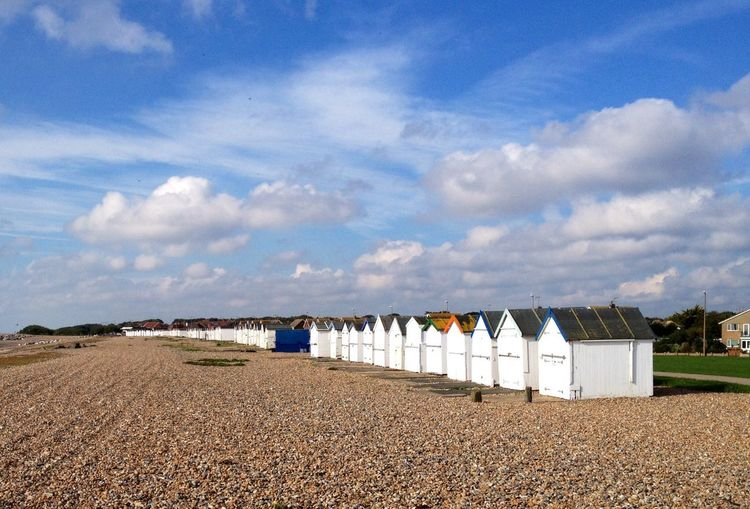 Beach Huts on the Beach in West Sussex Enjoying The Weekend!