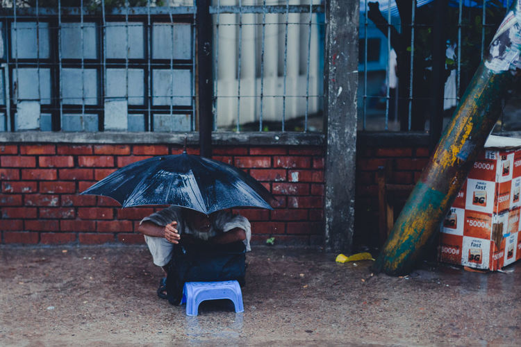 Begging in the rain Beggar Begging Brick Wall City City Life Color Palette Monsoon Old Man Outdoors Poor People  Poverty Rain Raining Rainy Day Urban Photography Adapted To The City Welcome To Black The Street Photographer - 2017 EyeEm Awards Adventures In The City