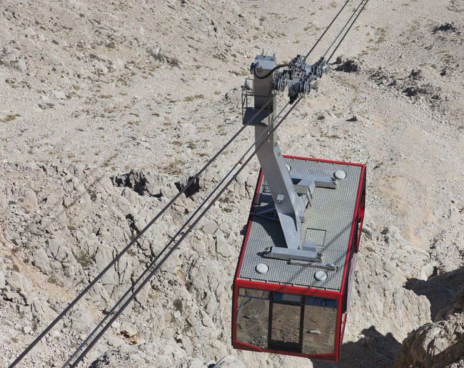 High Angle View Of Overhead Cable Car Hanging On Cable