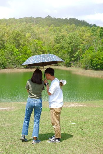 Rear view of couple standing in a lake