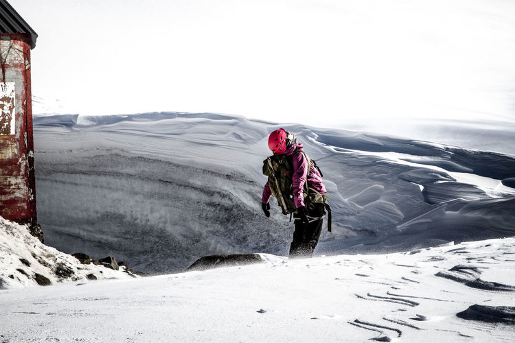 Low Angle View Of Hiker On Landscape In Snow