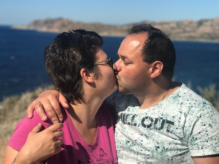 Couple kissing at corsica beach
