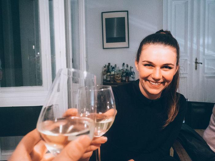 Portrait Of Happy Woman Toasting Wine At Restaurant