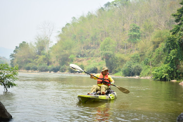 Water Outdoors Chiang Rai, Thailand Nautical Vessel Transportation Oar Tree River Plant Life Jacket Day Adventure Men Kayak Leisure Activity Nature Safety One Person Motion Lifestyles Rowing Paddling