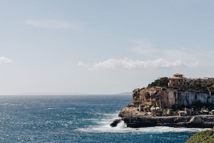Mallorca Mediterranean Sea Ocean View Ocean Side Architecture Beauty In Nature Breaking Waves Cliff Cliff Coast Day Horizon Over Water Mediterranean Building Nature No People Outdoors Rock - Object Scenery Scenics Sea Sky Water Waterfront Waves