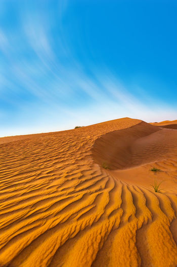 Marina Dubai Scenics - Nature Desert Sand Dune Sky Land Sand Landscape Climate Arid Climate Environment Beauty In Nature Tranquility Tranquil Scene Nature Non-urban Scene Blue No People Day Remote Sunlight Outdoors