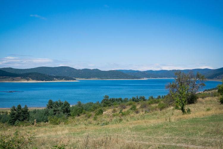 Batak Lake Beauty In Nature Blue Day Field Grass Landscape Mountain Mountain Range Nature No People Outdoors Scenics Sea Sky Tranquil Scene Travel Destinations Water