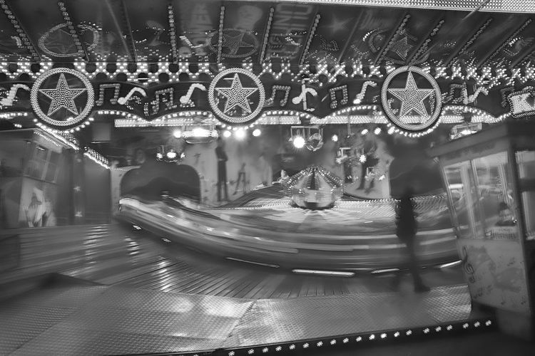 luna park Blurred Motion Amusement Park Carousel Amusement Park Ride Arts Culture And Entertainment Motion Illuminated Black And White Night Real People Unrecognizable People Lifestyles Merry-go-round