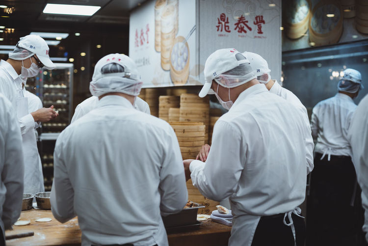 Photos from Taiwan-Trip 2017 Business Chef Commercial Kitchen Food And Drink Food And Drink Establishment Food And Drink Industry Group Of People Indoors  Kitchen Men Occupation People Preparing Food Real People Rear View Restaurant Standing Store Teamwork Uniform Working
