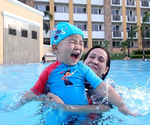 Happines to the Max Swimming Pool Water Togetherness Childhood Outdoors Smiling Happiness Express Yourself Expression Of Happiness Happy Baby Swimming Baby I Love Swimming Waki Dans Summer The Week On EyeEm