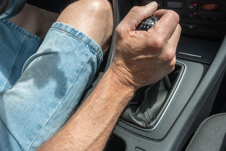 Midsection of man in car