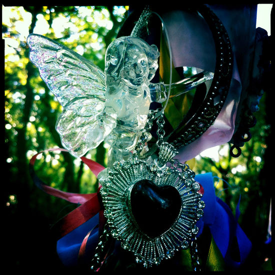 Glass fairy and necklace I left at the Fairy Tree in Aberfoyle Aberfoyle Fairy Fairy Tree Hipstamatic Inanimate Objects Offering Orange Scotland Scottish Shrine Silber Square Tree Votive