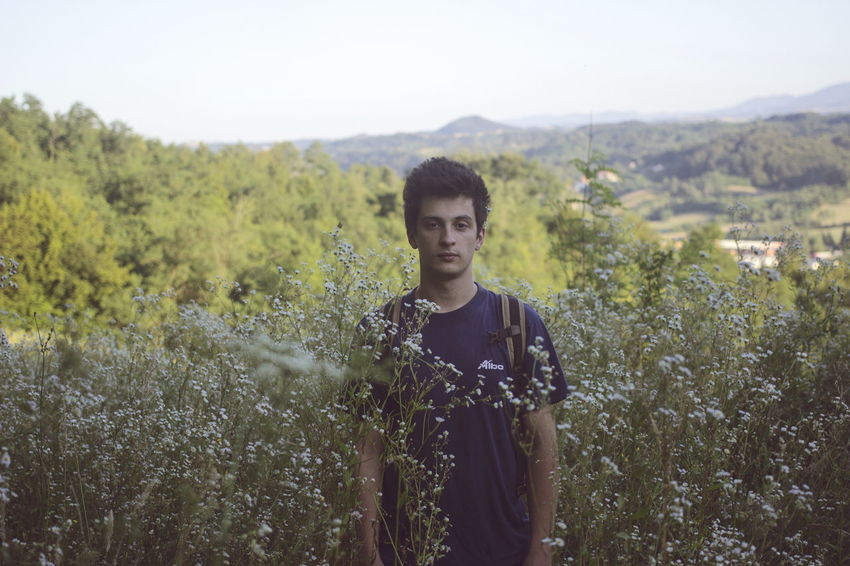 One Man Only One Young Man Only Young Adult Portrait Nature Handsome Beautiful People Waist Up Beauty Tranquility Serbia Travel Nature Green Color Grassy Footpath Scenics Countrylife Hills, Mountains, Sky, Clouds, Sun, River, Limpid, Blue, Earth Landscape Flowers Village