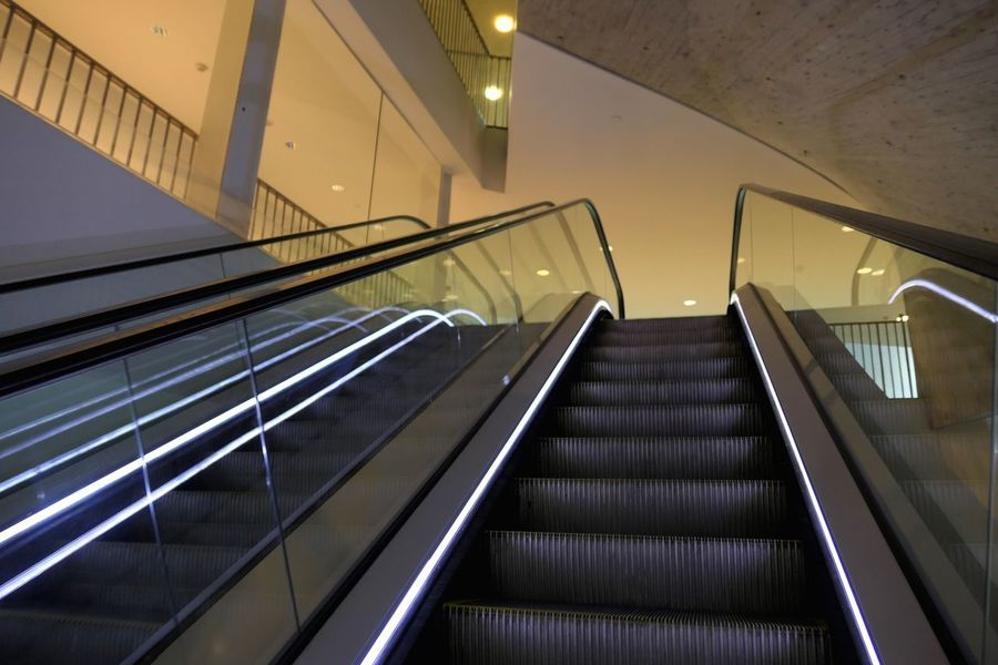 Staircase Steps And Staircases Railing Architecture Built Structure Escalator The Way Forward Direction Illuminated Indoors  Convenience Technology Low Angle View No People Modern Transportation Empty Diminishing Perspective Connection Steel