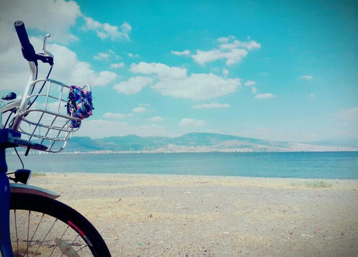 Sky Cloud - Sky Bicycle Transportation Sea Water Mode Of Transport Day Beach Outdoors Scenics Nature Beauty In Nature Stationary Horizon Over Water No People Bysicle More
