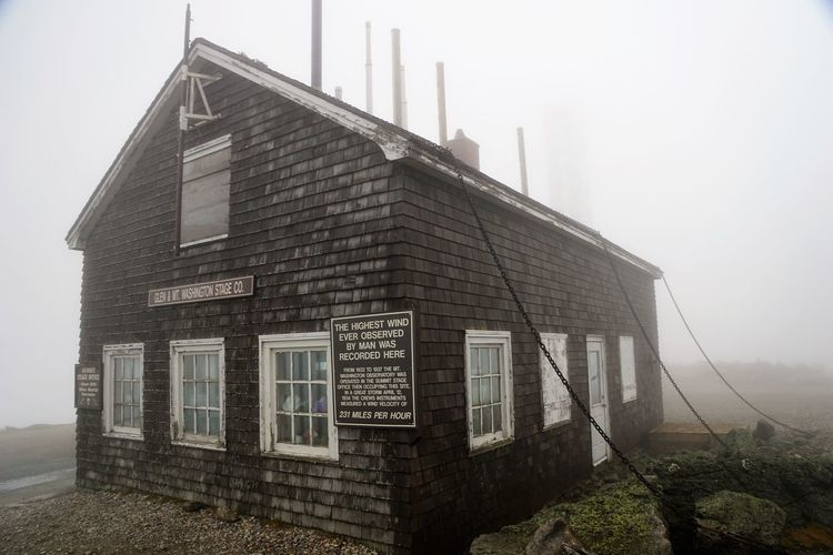 Building at top of Mt. Washington that experienced the highest winds ever recorded - 231 miles per hour. Architecture Building Exterior Built Structure Day Fog House Mountain Top Mt Washington New Hampshire, USA No People Outdoors Sky Weather Station