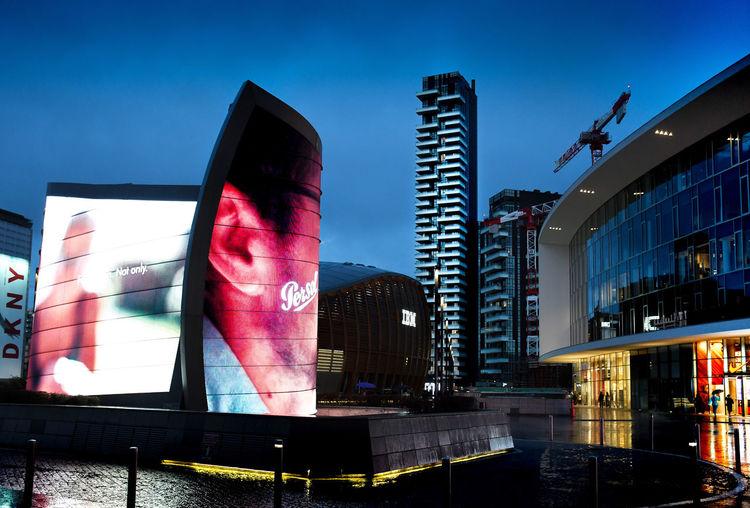 Modern buildings against blue sky in city