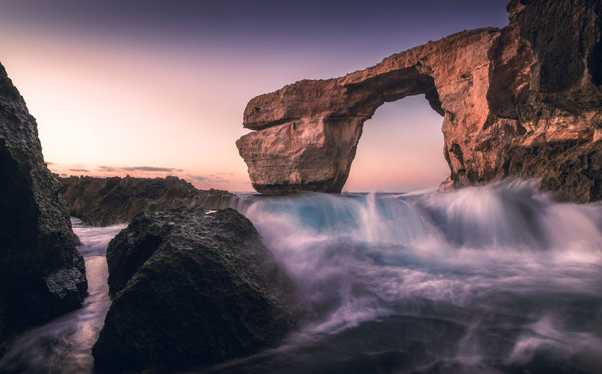 Arch Azure Window Beauty In Nature Cliff Day Gozo Long Exposure Longexposure Malta Motion Natural Arch Nature No People Outdoors Physical Geography Power In Nature Rock - Object Rock Formation Scenics Sea Sky Sunset Tranquil Scene Tranquility Water