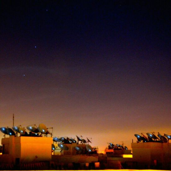 Agadir Maroc Satellite dishes illuminated by tonight's full moon