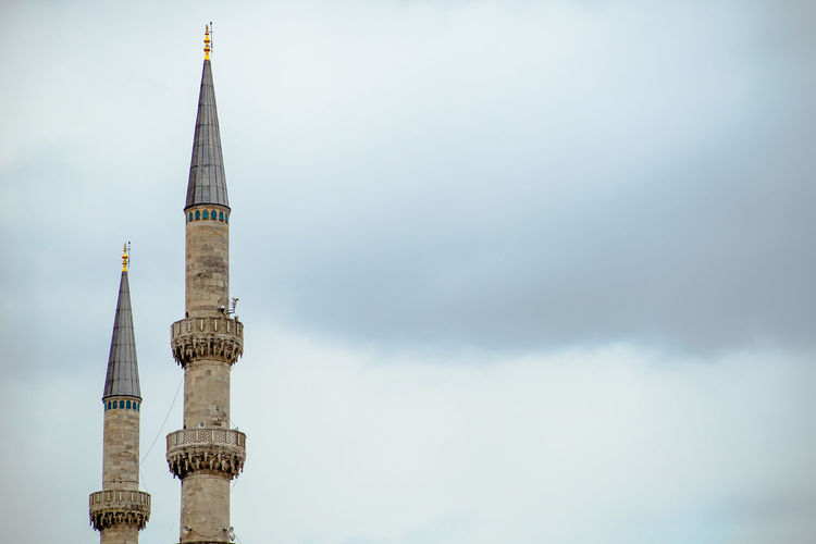 Two minarets rising to the sky Architecture Religion Place Of Worship Tall - High Cloud - Sky Travel City Belief No People Outdoors Minaret Mosque Turkey Istanbul Muslim Island