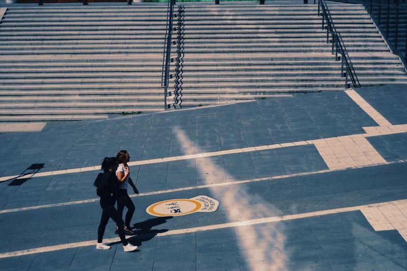 High angle view of man walking on street