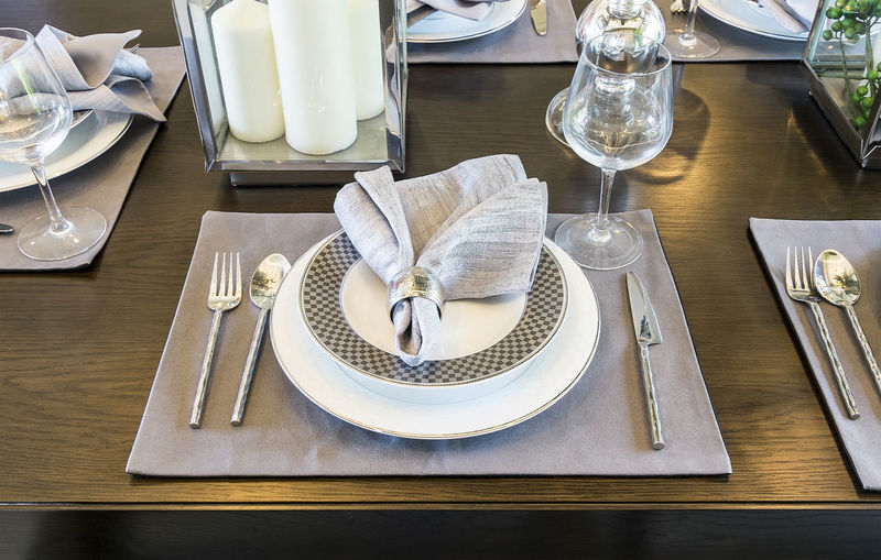 Place setting on dining table at home