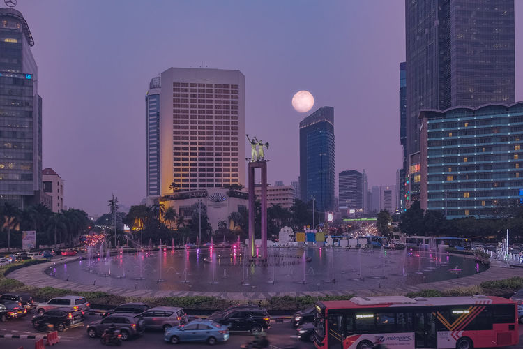 SuperMoon 2018 Architecture Building Building Exterior Built Structure Car City Cityscape Financial District  Illuminated Jakarta Indonesia Land Vehicle Lunar Eclipse 2018 Mode Of Transportation Modern Motor Vehicle Night No People Office Office Building Exterior Outdoors Purple Sky Skyscraper Street Tall - High Tower Transportation