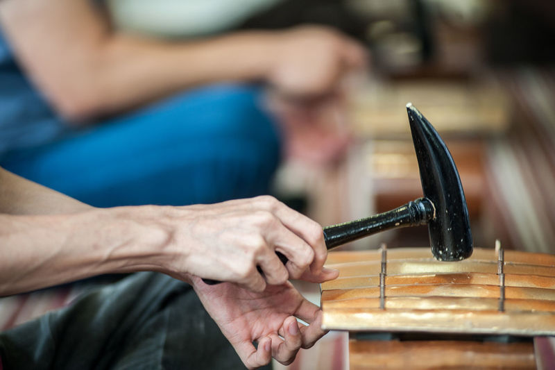 Close-up Cropped Day Focus On Foreground Gamelan Guitar Holding Human Finger Leisure Activity Lifestyles Musician Part Of Person Selective Focus Skill  Unrecognizable Person Work Tool