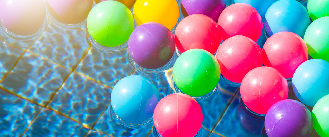 High angle view of multi colored balls in water