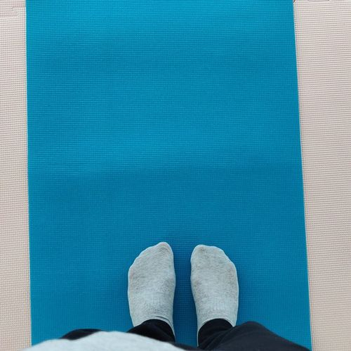 Low section of person in socks standing on carpet