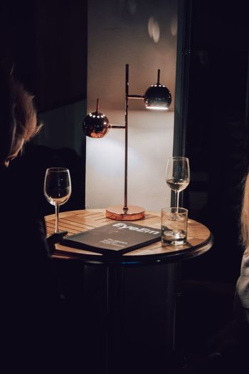Close-up of wine glasses on table at home