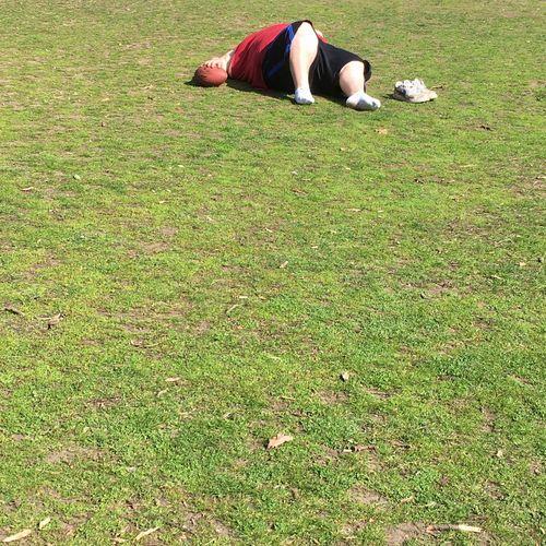 Side view of woman lying on field