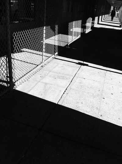 NYC street Absence Black And White City Life Cobblestone Fence Light And Shadow Narrow Pattern Pavement Paving Stone Shadow Sidewalk Street The Way Forward Urban Wall - Building Feature