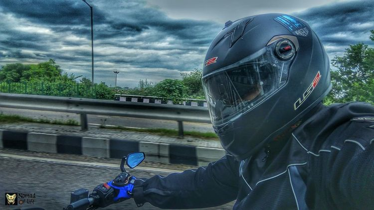 Riding the storm 🇮🇳😎 Cloud - Sky Adult One Person People Adults Only Sky Outdoors Day Headwear Traveldiaries India Rainy Days☔ Highwayphotography Wanderlust Photography Passion Nomad EyeEm Eyeemphotography Motorcycle Photography Motorcycle Bikelife Highways&Freeways Travelgrams Traveldiary2017 NOMAD