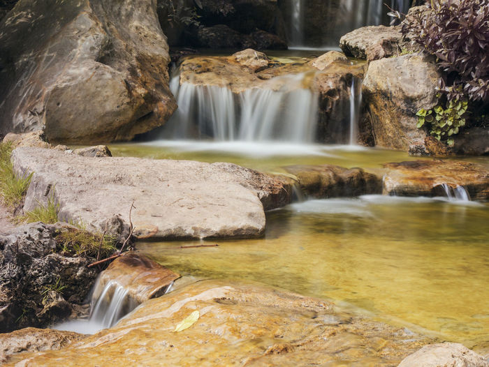 Beauty In Nature Blurred Motion Day Falling Water Flowing Flowing Water Forest Long Exposure Motion Nature No People Non-urban Scene Outdoors Power In Nature Rainforest Rock Rock - Object Rock Formation Scenics - Nature Solid Stream - Flowing Water Tree Water Waterfall