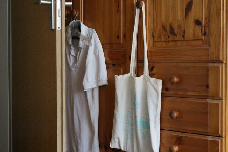 Shopping bag hanging on cabinet at home