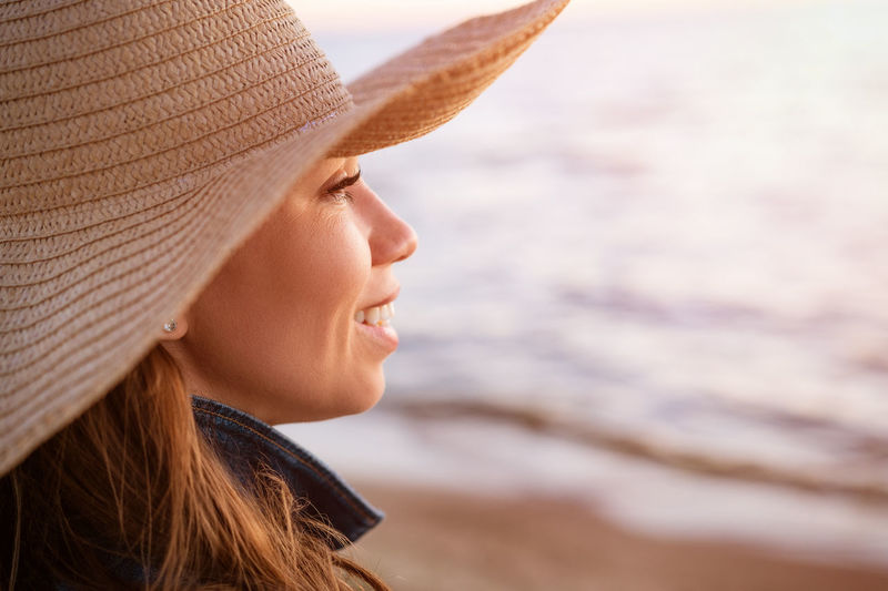 Portrait of woman looking away at beach