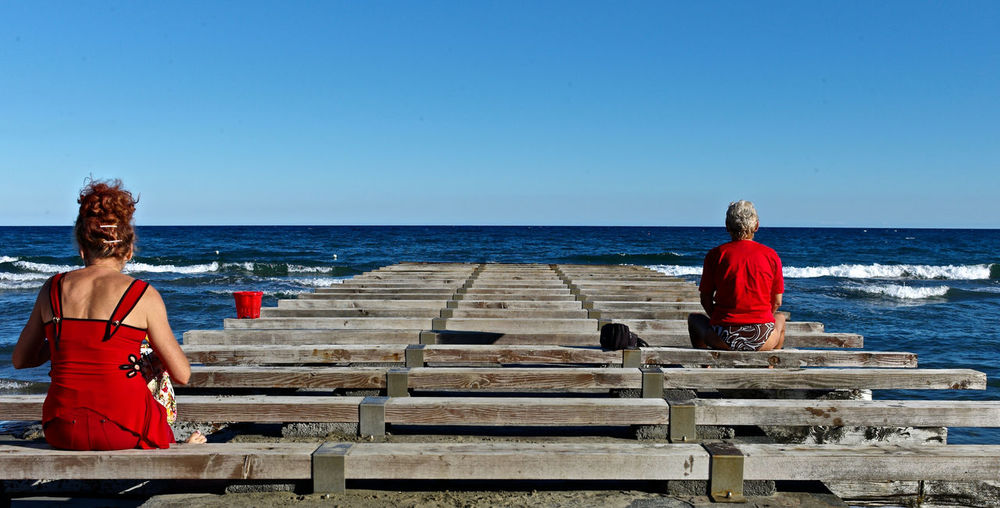 Meditation Place Red Blue Beach Day Colourcontrast Men In Red Shirt Seaside Silence Woman In Red
