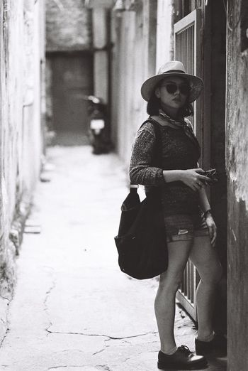 B&W Collection Portrait Of A Woman Vietnam Architecture Asian Garden B&w Photography Building Exterior Built Structure Bw Day Filmphotography Full Length Headwear One Person Outdoors People Portrait Real People Black & White Friday