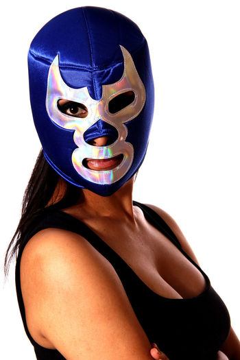 Portrait Of Woman Wearing Mask Against White Background