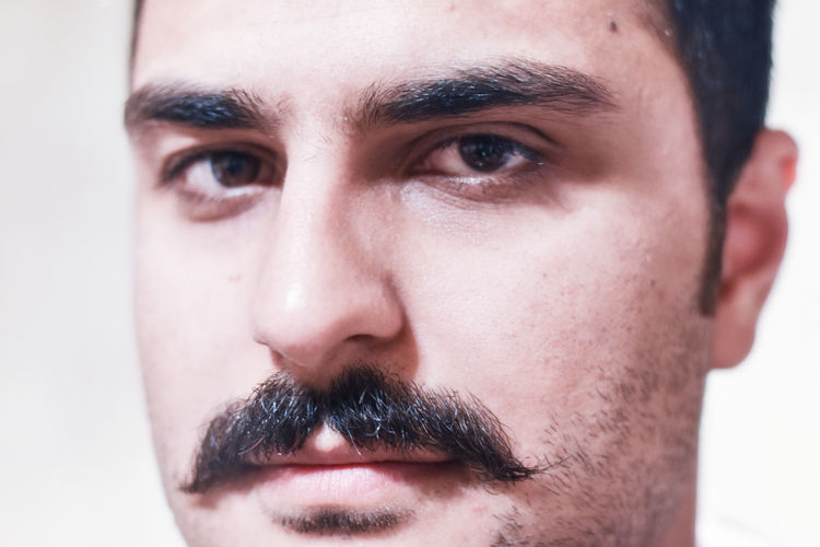 Close-Up Portrait Of Young Man With Mustache