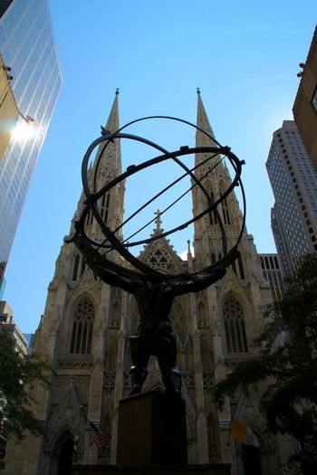 Atlas Back View Cathedral Church City Fifth Avenue NYC New York New York City Rockefeller Center St Patrick's Cathedral Statue Architecture Atlas Statue Bottom View Bronze Sculpture Bronze Statue Building Exterior Built Structure Church Towers Clear Sky Day Front View Low Angle View No People Sculpture