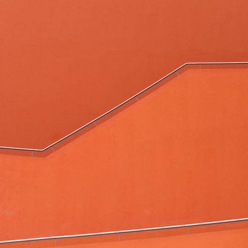 Close-up of orange spiral staircase