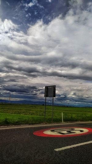 Street Sign Blue Sky And Clouds Prairie Green Grass Road Sky Building Exterior Built Structure Cloud - Sky Architecture Landscape Storm Cloud Scenics Idyllic Tranquil Scene Thunderstorm Tranquility Sky Only Overcast