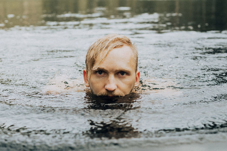Portrait Of Young Man Swimming In Lake