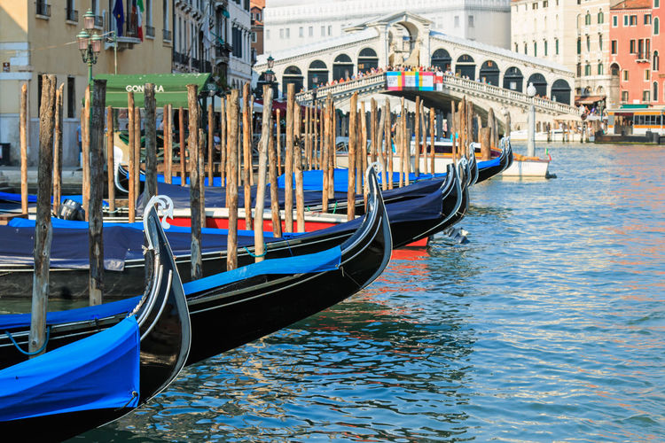 Venice, Italy - June 28, 2014: Gondolas and small boats on the Grand Canal in Venice, Italy, close to Rialto bridge. Some tourists admiring the stunning view. Architecture Building Exterior Canal Canal Grande City Cultures Gondola Gondola - Traditional Boat Gondolier Horizontal Italy Multi Colored Nautical Vessel Outdoors People Ponte Di Rialto Rialto Saint Mark's Square Tourism Transportation Travel Travel Destinations Vacations Venezia Water