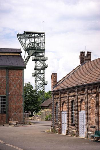 View of metallic structure against sky in city, lwl-industriemuseum zeche zollern